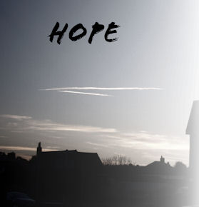 a photo of the sky, above some rooftops and the word hope