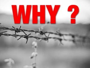 a black and white photo barbed wire with the word Why in red ?